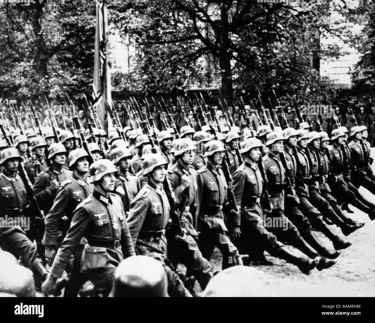 1940s GERMAN TROOPS MARCHING GOOSE STEPPING IN STREETS OF WARSAW POLAND 1941 - Stock Image