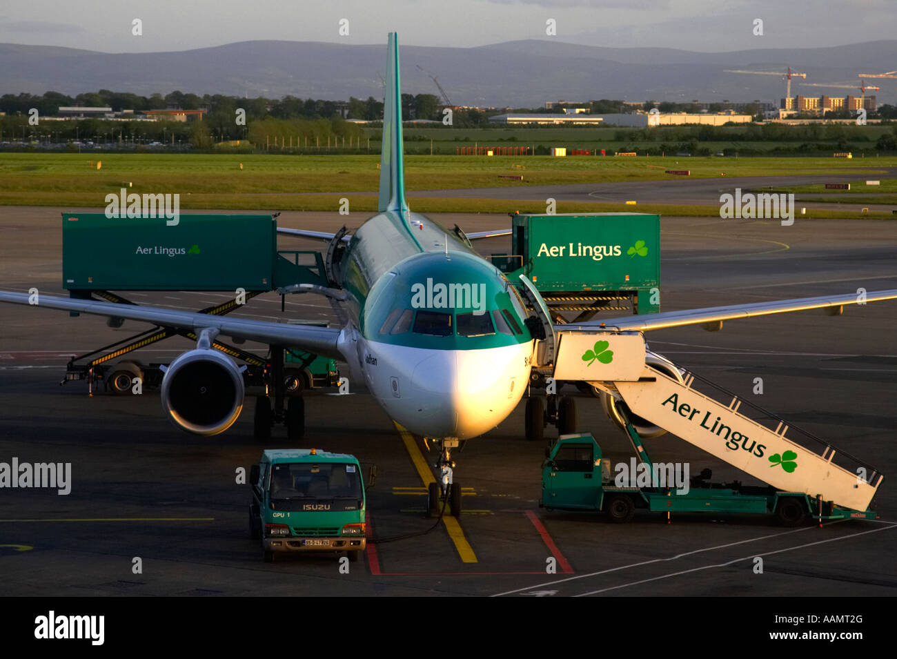 Aer Lingus Airbus A320 211 EI CPG St Aodhan sitting in evening sun on the apron with steps and aer lingus van being - Stock Image