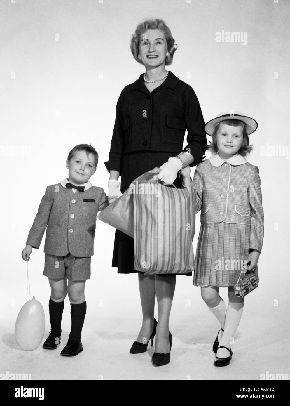 1950s 1960s Woman Mother Two Children Boy Girl Holding
