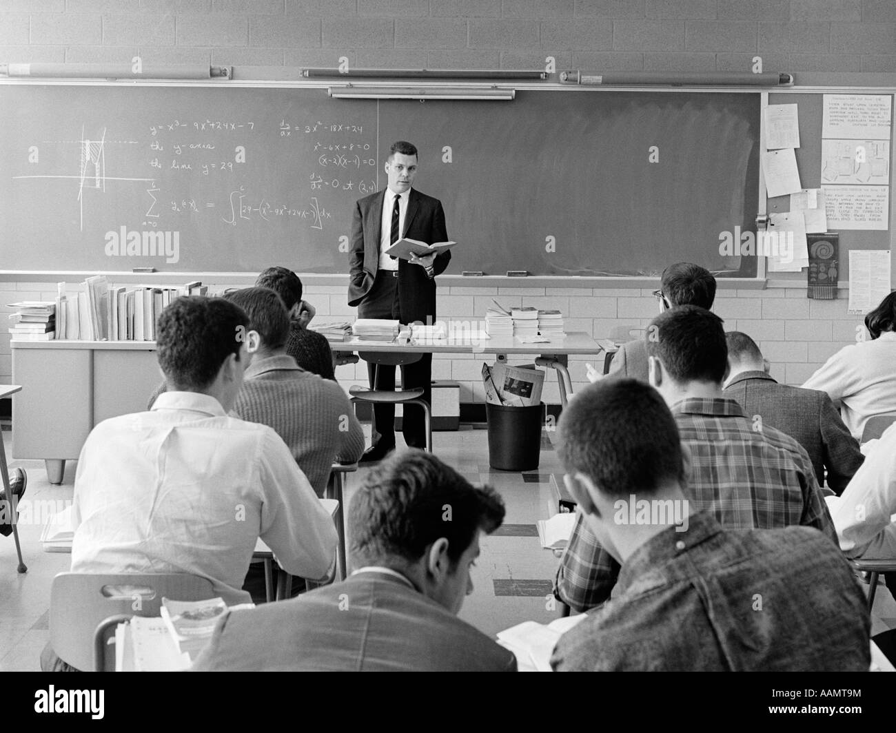 1960s Back View Of Classroom With Teacher Standing Behind Desk With
