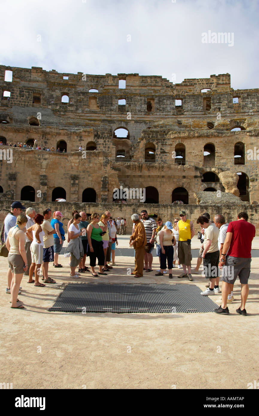 tour guide explains to group of british tourists about gladiator pits on the floor of the arena of the old roman - Stock Image