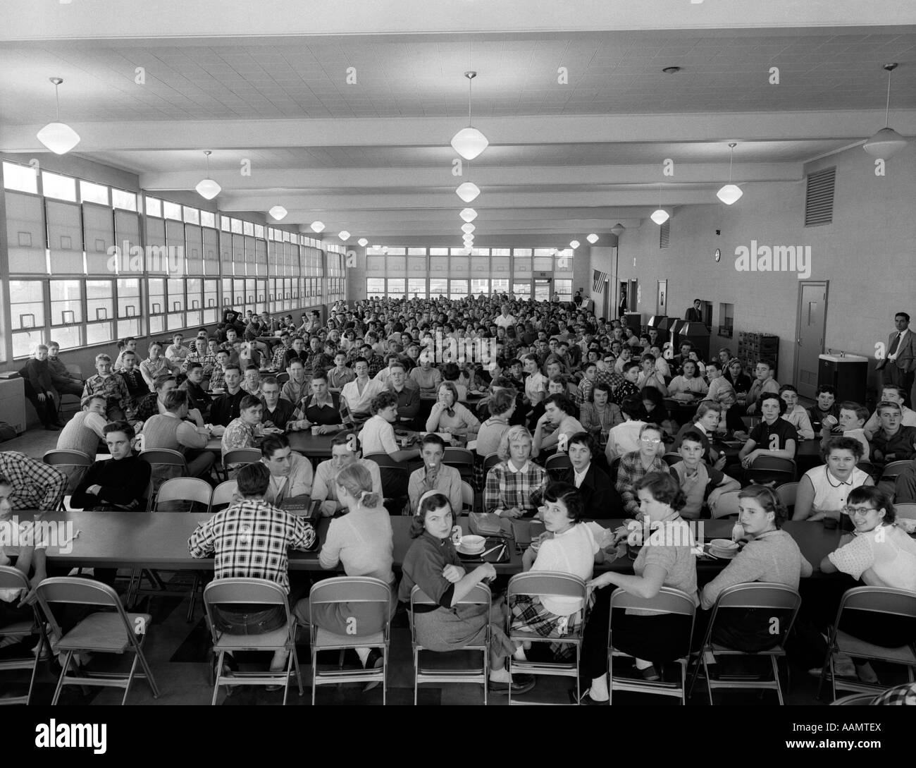 1950s CROWDED HIGH SCHOOL CAFETERIA Stock Photo: 12665137 ...