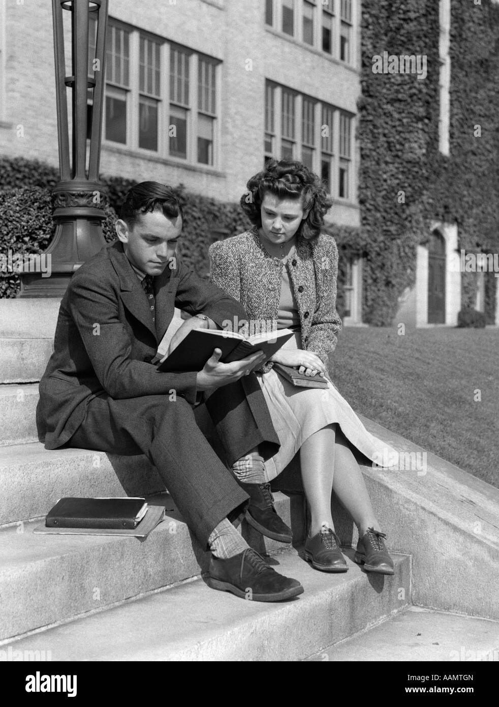 1940s 1930s MALE & FEMALE COLLEGE STUDENT STUDYING OUTSIDE ...