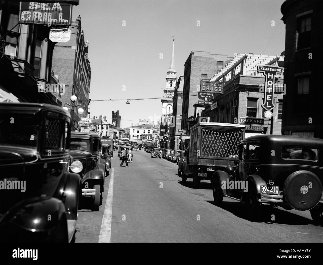 1930s 1935 MAIN STREET SMALL TOWN AUTOMOBILE TRUCK PEDESTRIAN TRAFFIC IN PORTSMOUTH NEW HAMPSHIRE USA - Stock Image