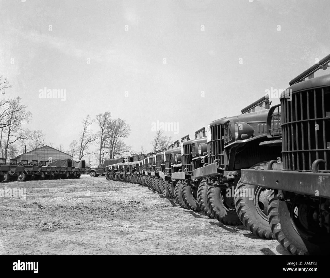 1940s APRIL 19 1941 ALIGNMENT ROW ROWS DODGE ARMY TRUCKS FORT DIX NJ - Stock Image