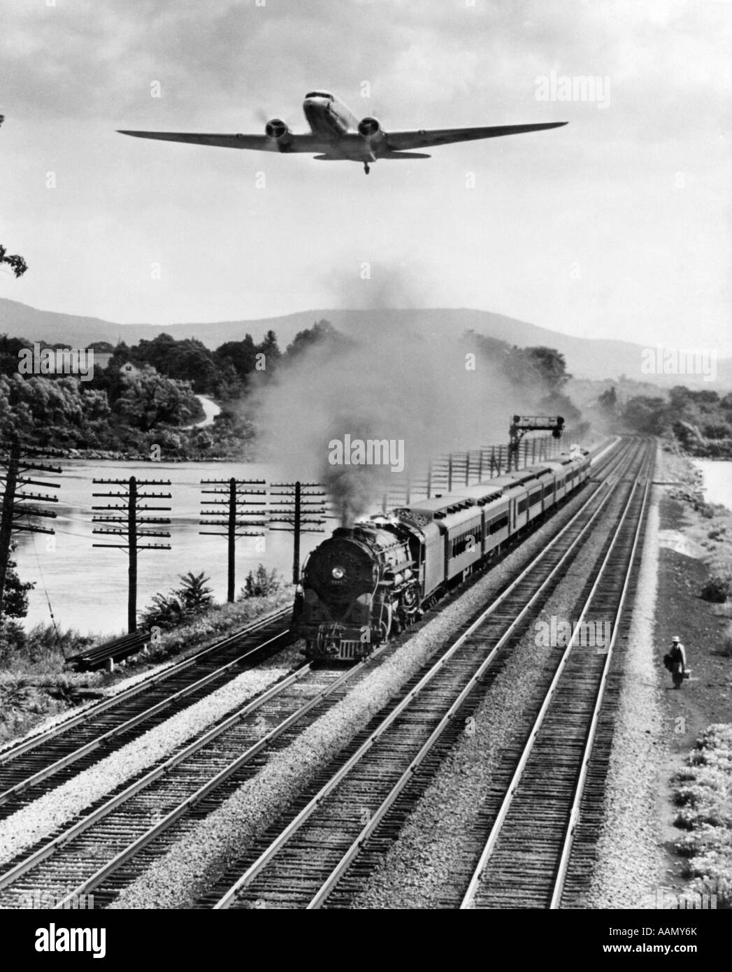 1930s 1940s THREE FORMS OF TRANSPORTATION MAN WALKING BY TRAIN TRACKS 4MPH LOCOMOTIVE 40MPH AIRPLANE ABOVE 200MPH - Stock Image
