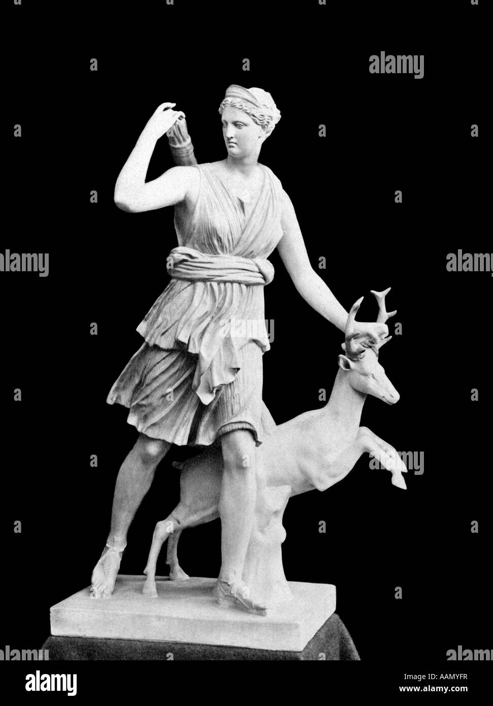 MARBLE STATUE OF DIANA ROMAN GODDESS OF MOON FORESTS ANIMALS ALSO KNOWN AS GREEK GODDESS ARTEMIS - Stock Image