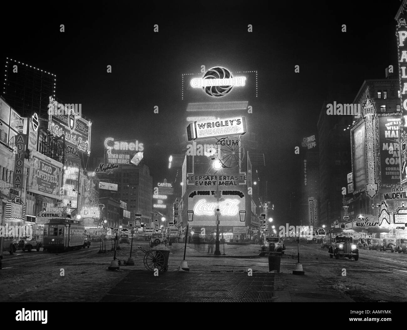 1935 NYC TIMES SQUARE LIGHTED AT NIGHT BROADWAY'S GREAT WHITE WAY - Stock Image