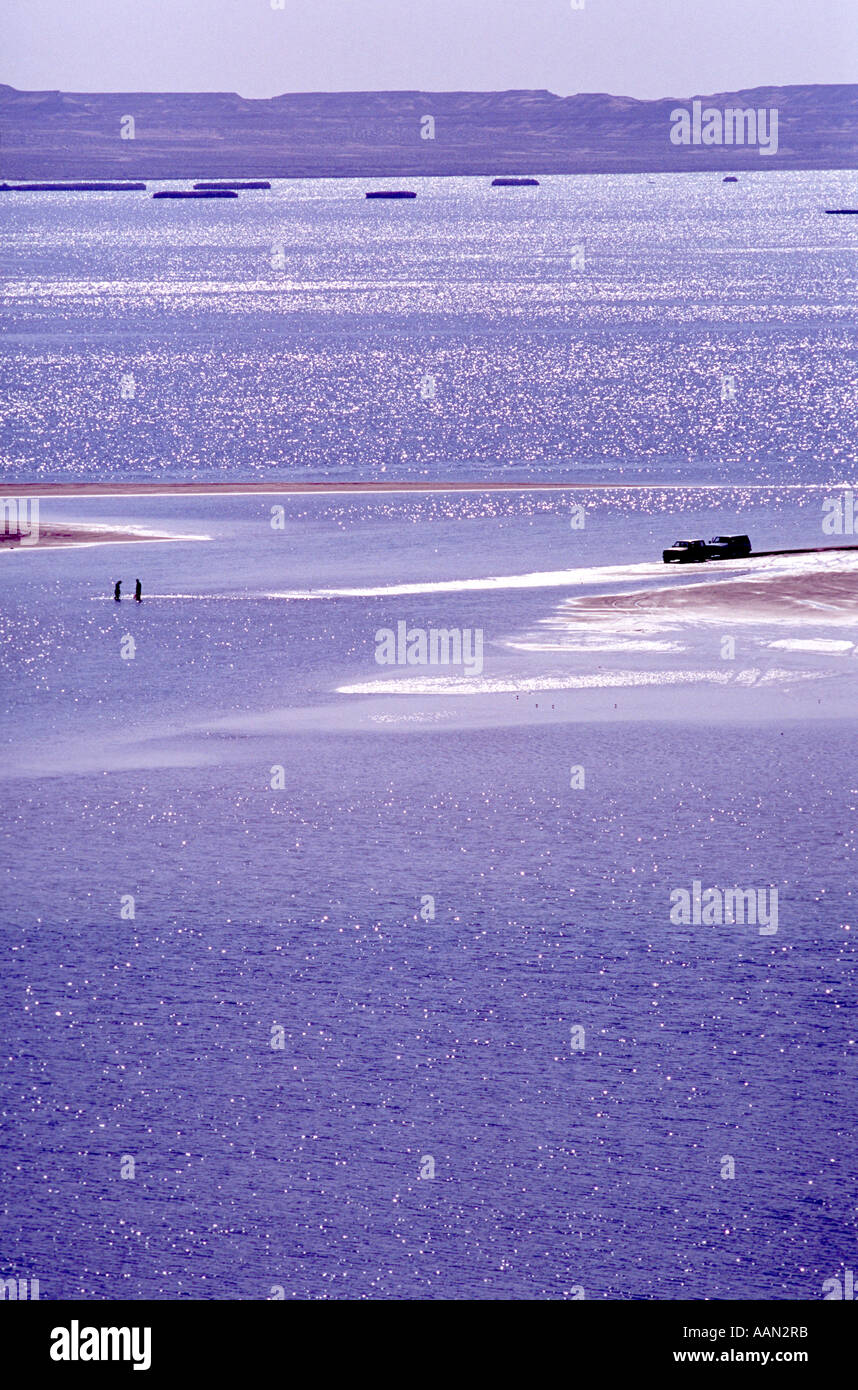 4x4 driving and fishing on the Inland sea Khor al Udeid  south of Doha in Qatar in the Arabian Gulf Middle East - Stock Image