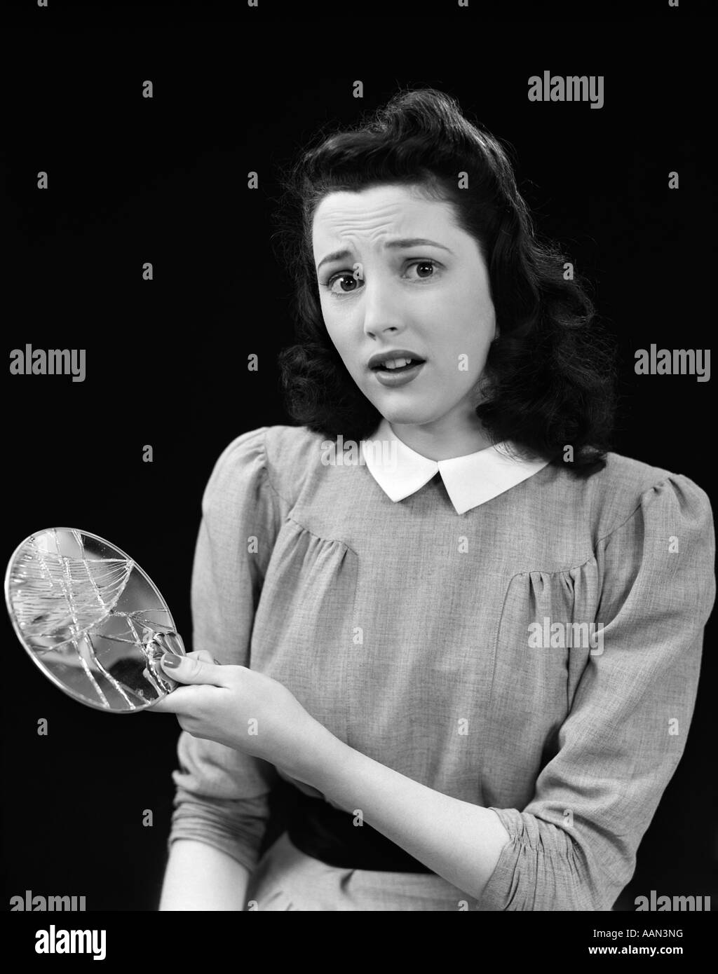 woman holding mirror. Perfect Woman 1940s WOMAN HOLDING BROKEN MIRROR LOOKING AT CAMERA WITH WORRIED FACIAL  EXPRESSION SEVEN YEARS BAD LUCK To Woman Holding Mirror O