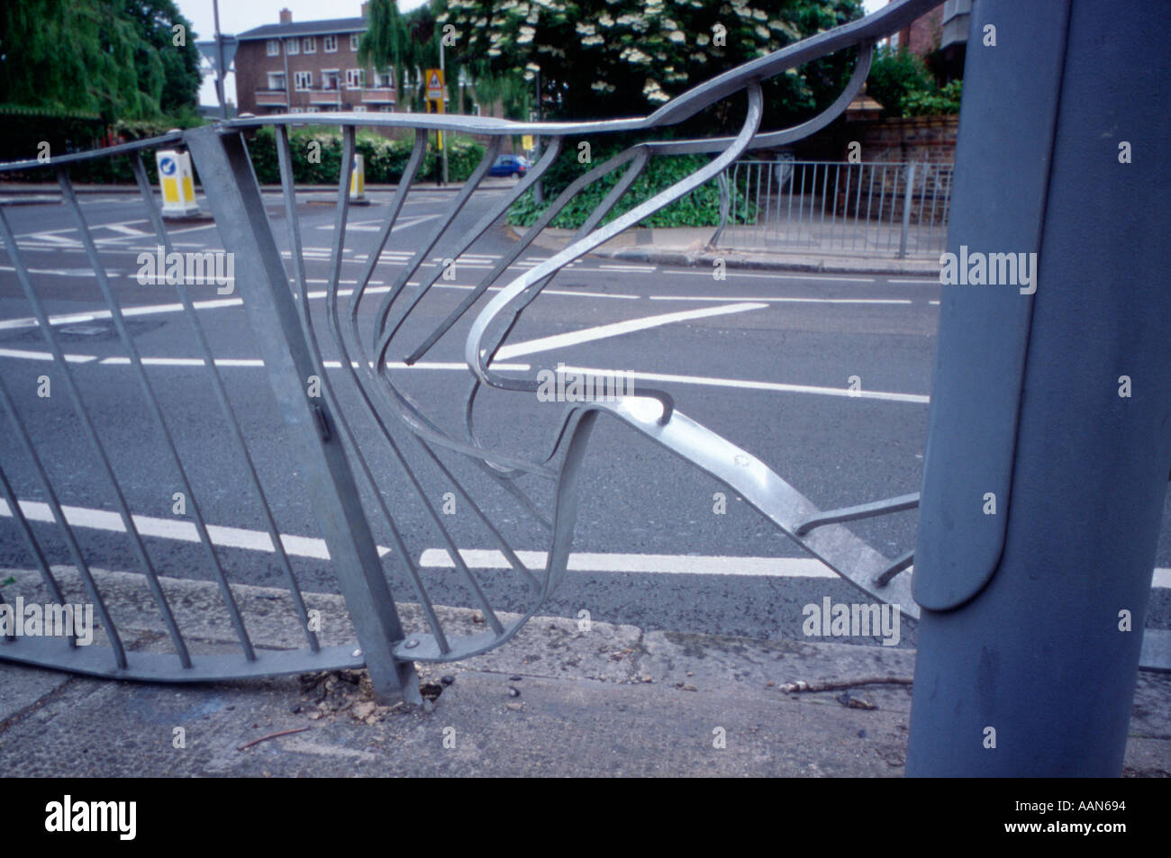 Buckled railings next to roadside after traffic accident
