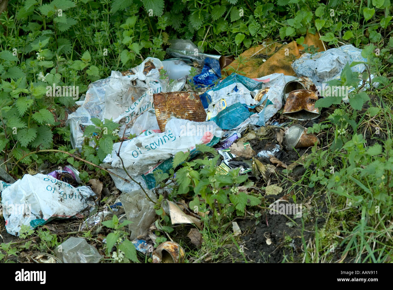 fly tipping waste environment counryside refuse dirt mess throw away grass countryside rubbish junk scrap trash dross garbage l - Stock Image