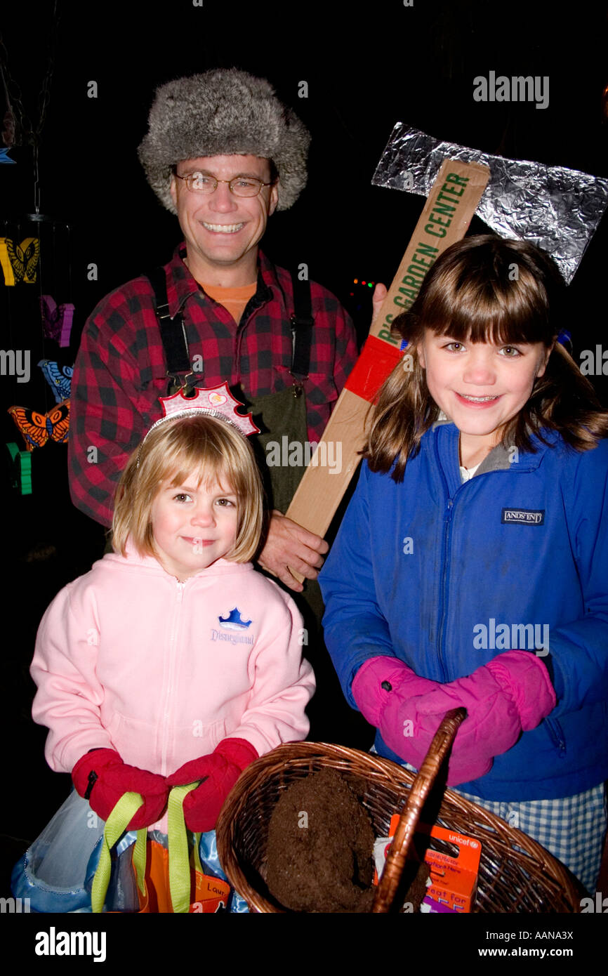 trick and treaters with paul bunyan father for halloween st paul minnesota usa stock