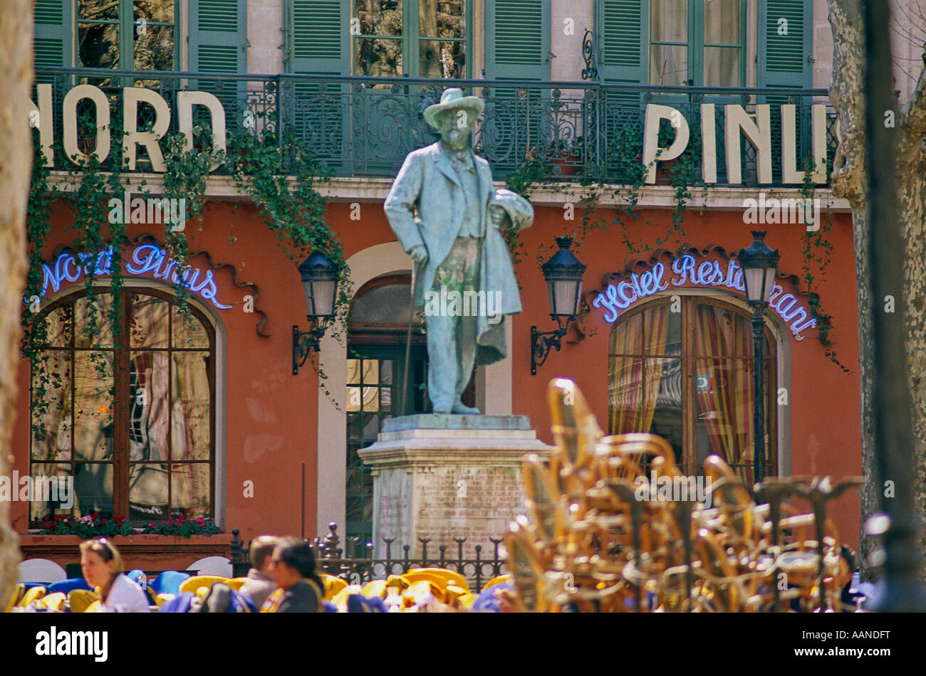 Statue of Mistral and cafe outside the Hotel Nord Pinus, Arles, Bouches du Rhone, Provence, France - Stock Image