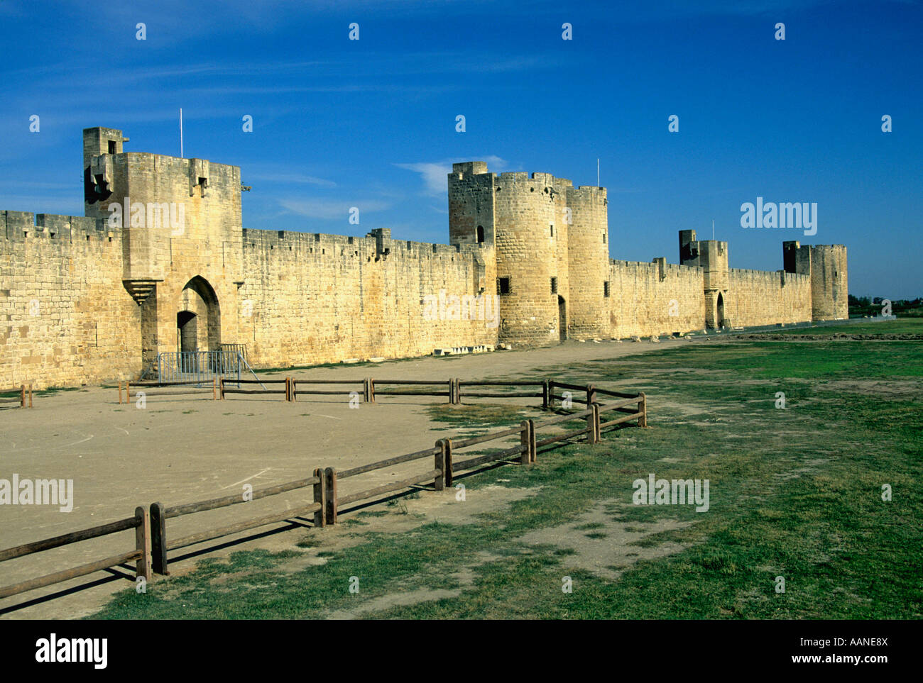 Medieval city walls of the town of Aigues-Mortes, Bouches du Rhone, France, Europe - Stock Image