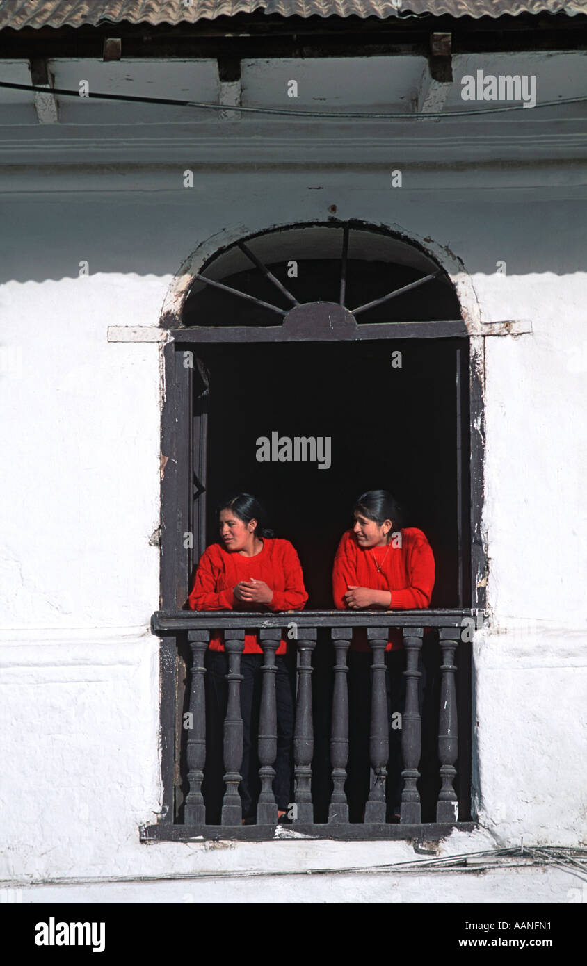 Two women standing at a balcony looking to the left overlooking the plaza in Cajamarca Northern Peru South America - Stock Image