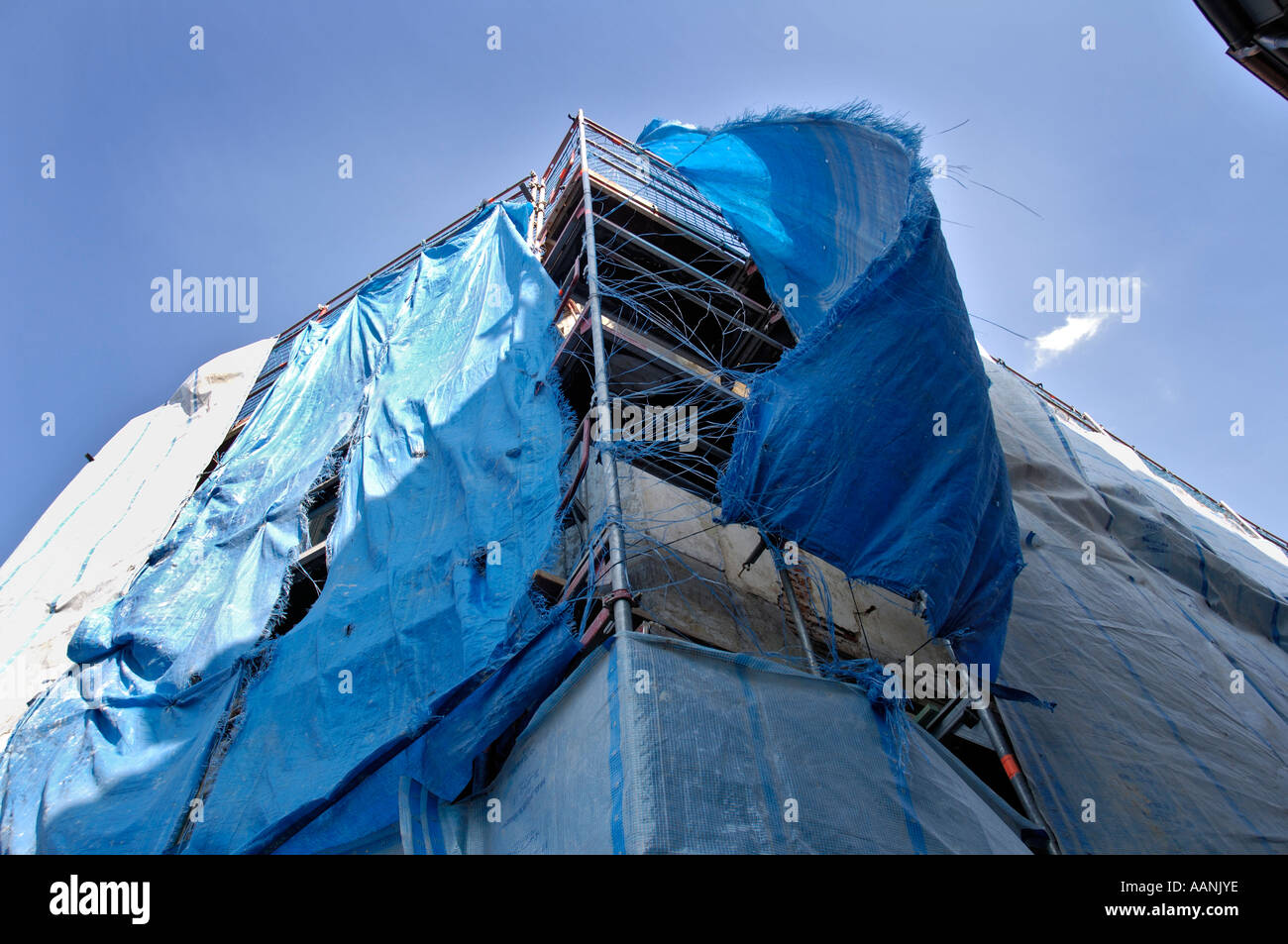 Scaffold with torn covers, Bamberg, Upper Franconia, Bavaria, Germany - Stock Image