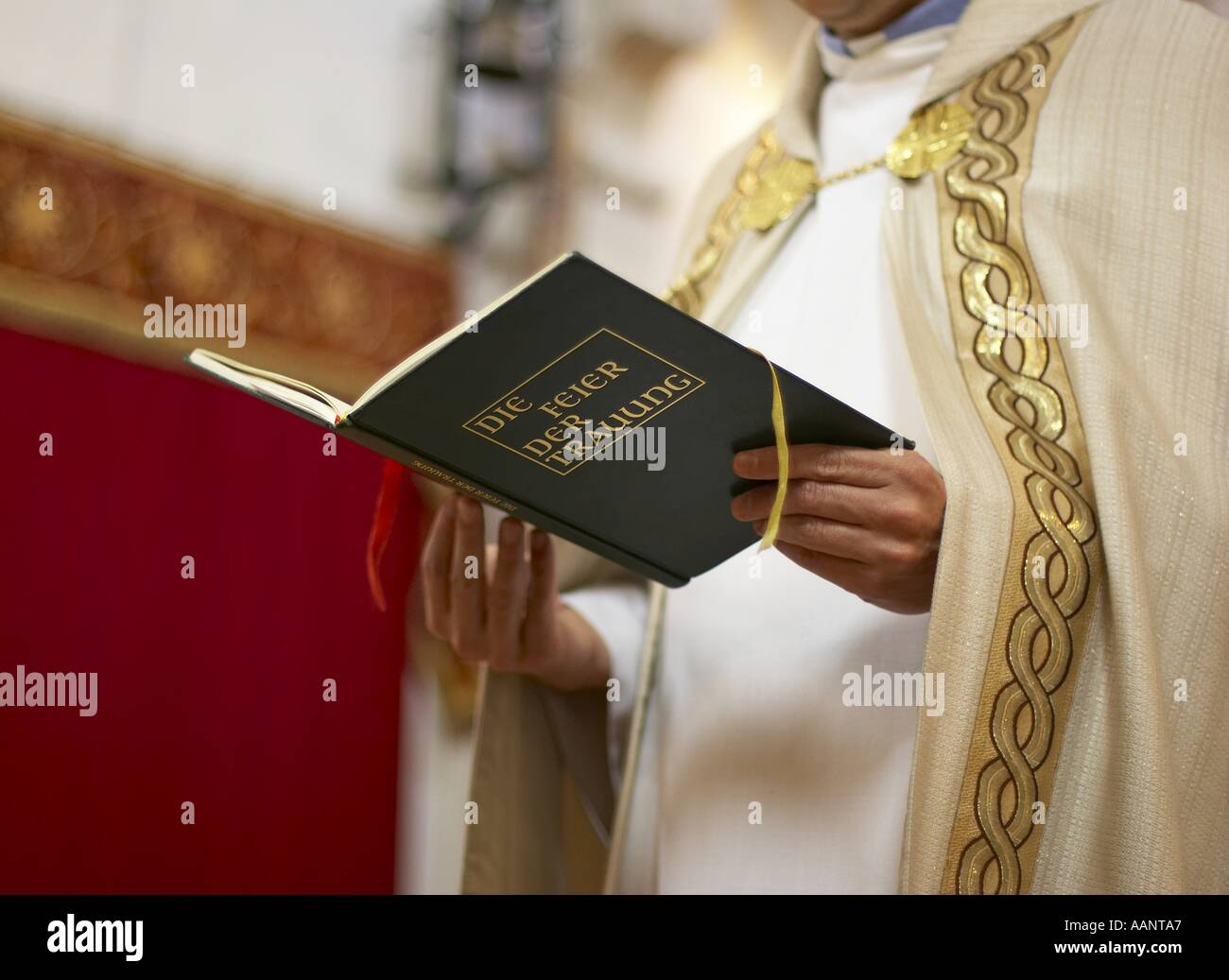 priest at wedding / reading from book of marriage - Stock Image