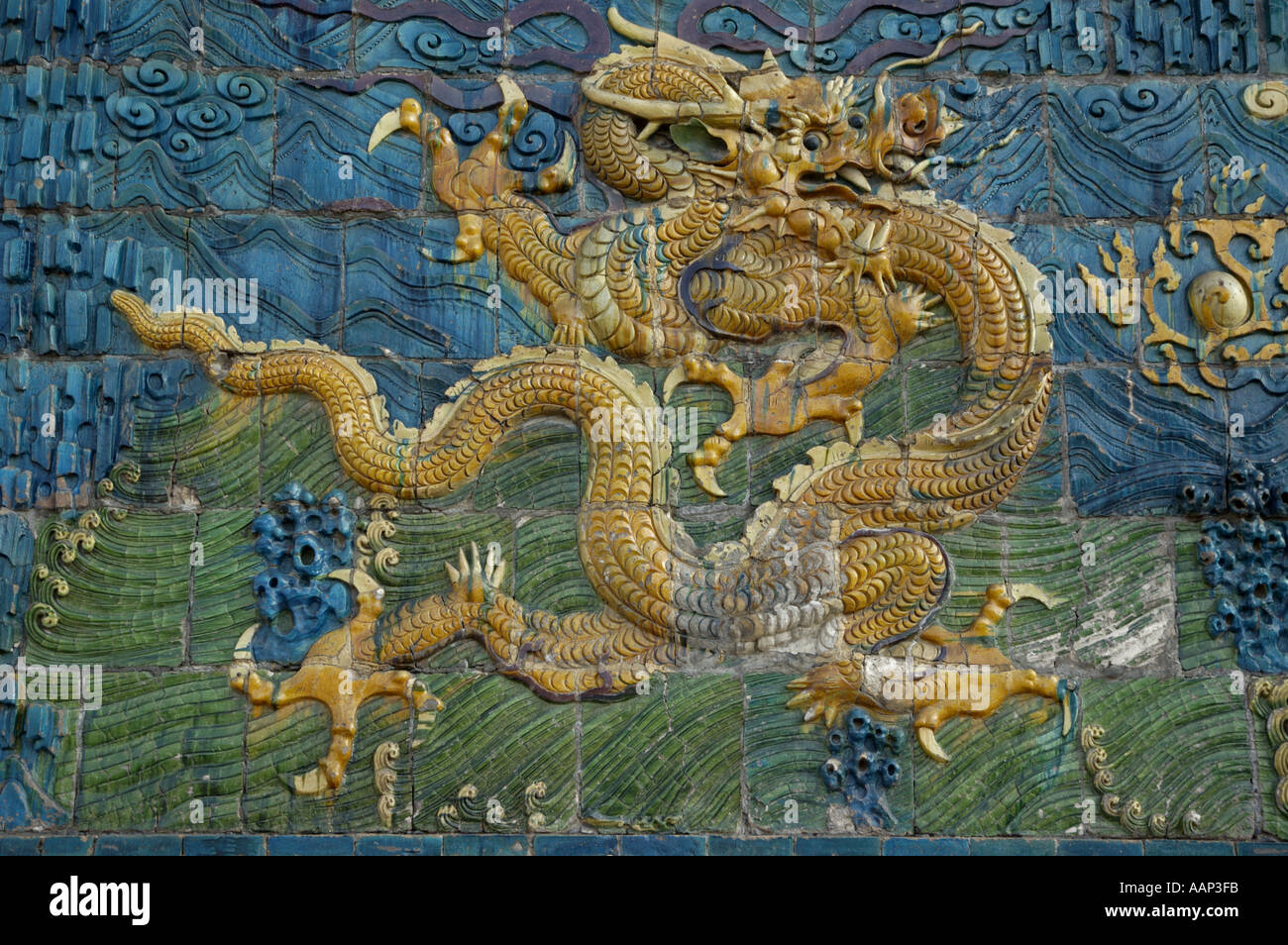 Ornate and decorative Chinese dragon painting on the Nine Dragon Screen in Datong, Shanxi, China. - Stock Image