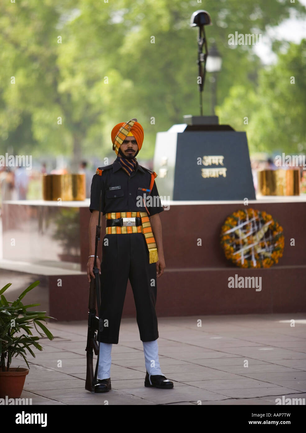 Amar jawan jyoti india gate stock photos amar jawan jyoti india a soldier standing guard at the amar jawan jyoti the flame of the immortal warrior altavistaventures Choice Image