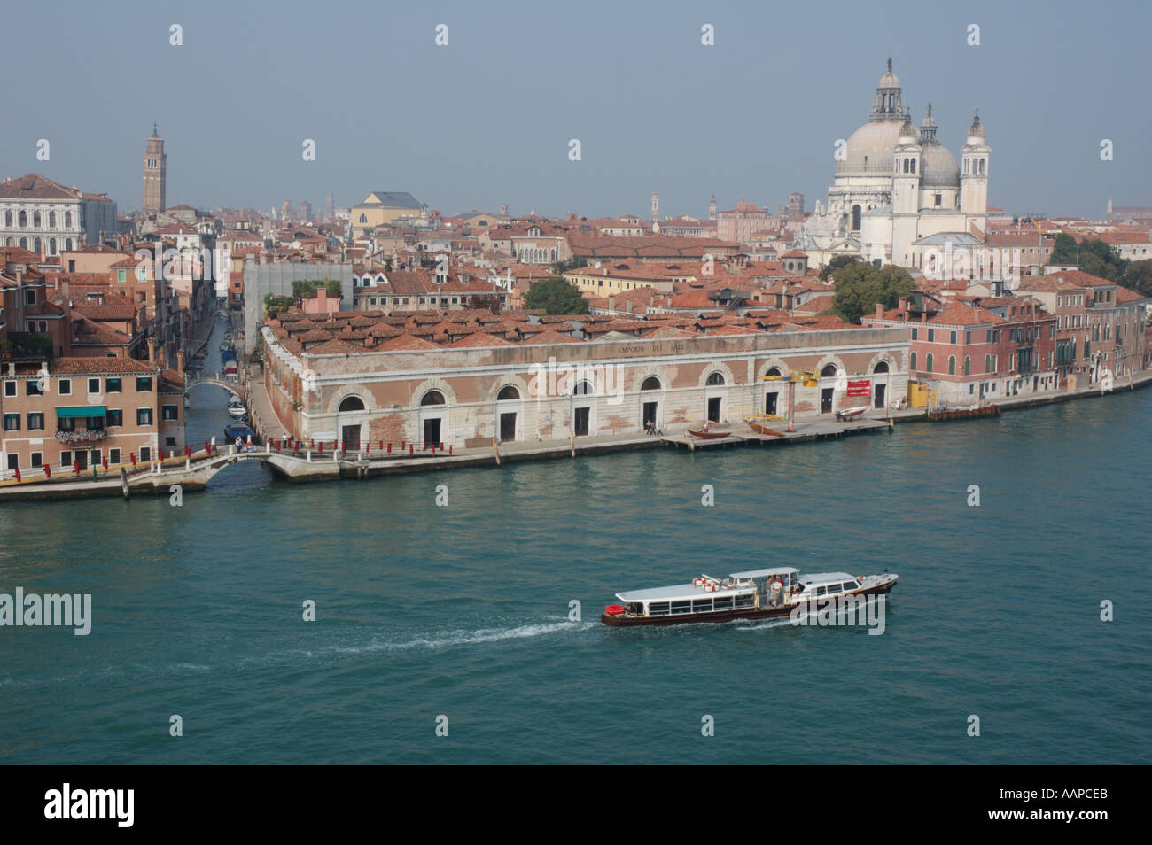 Aerial view of a vaporetto water bus heading east along the Giudecca Canal towards St Marks Square in Venice - Stock Image