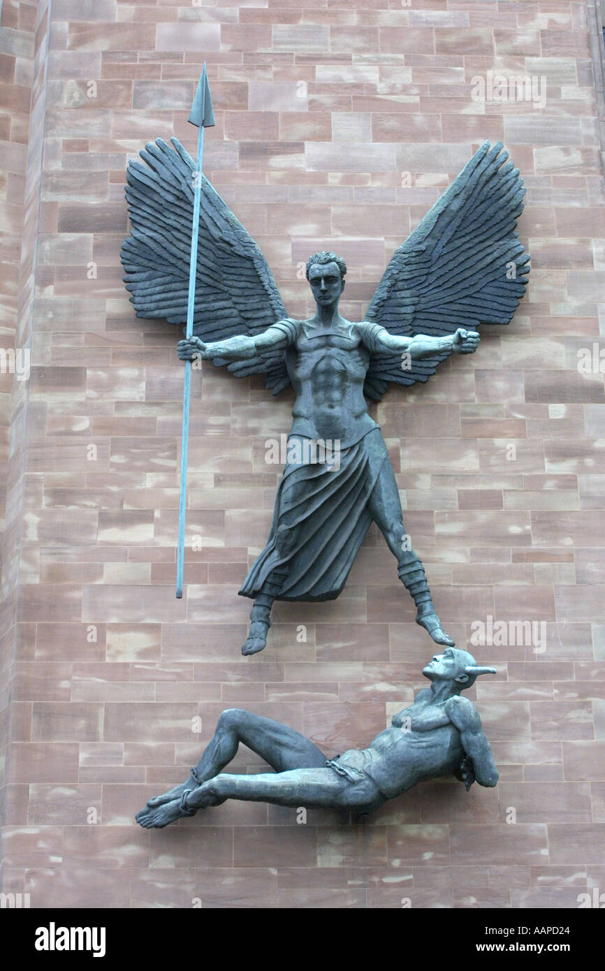 St Michael Slaying the Devil by Sir Jacob Epstein outside Coventry Cathedral England - Stock Image