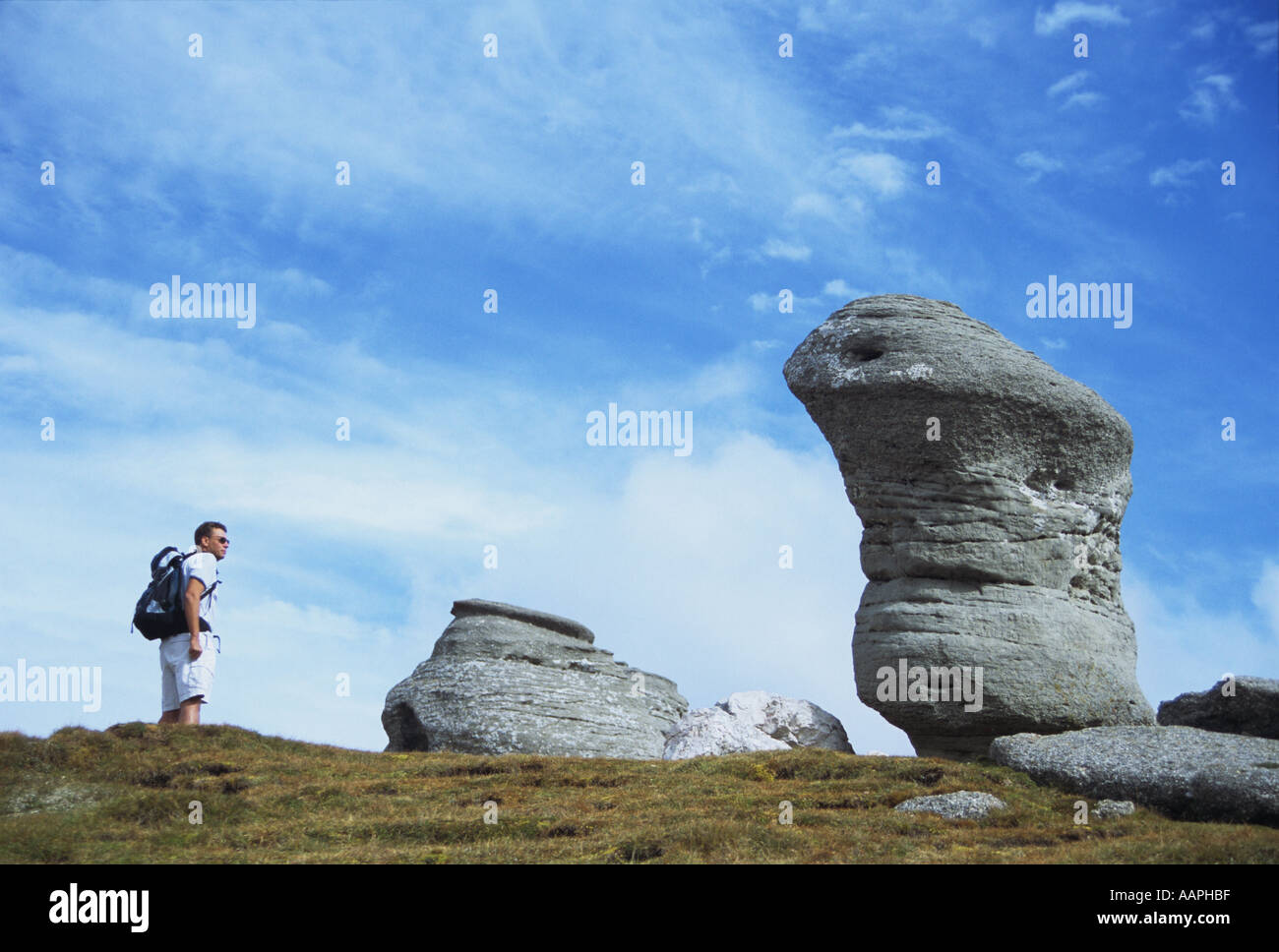 Walking amongst rock formations in the Bucegi mountains Romania Stock Photo