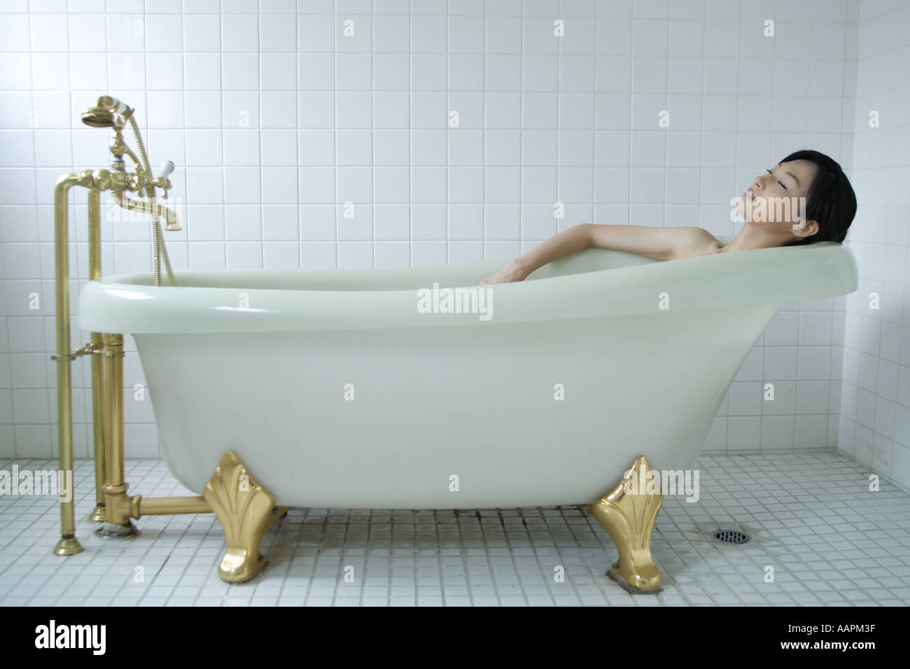 A young woman in bathtub, side view Stock Photo: 4140094 - Alamy