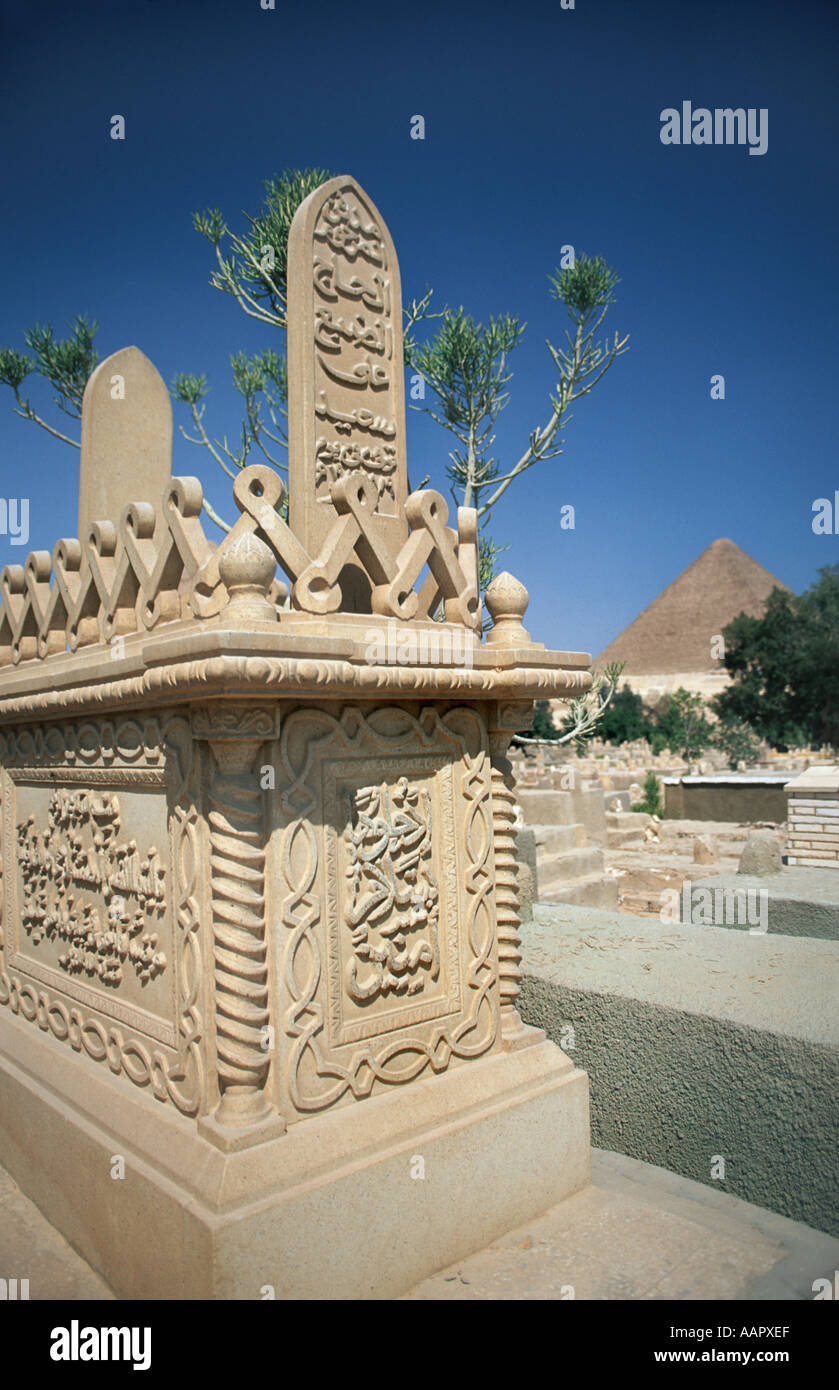 Ornately decorated tomb in the muslim cemetery Giza Cairo Egypt Pyramid in the background - Stock Image