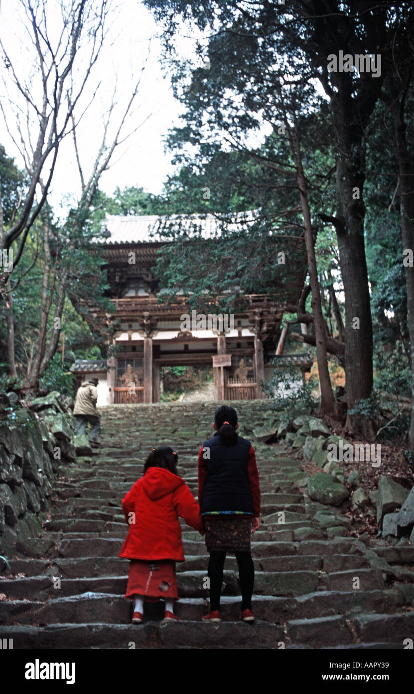 Japanese children walking up steep stone steps to a Japanese temple Shiga prefecture Japan - Stock Image