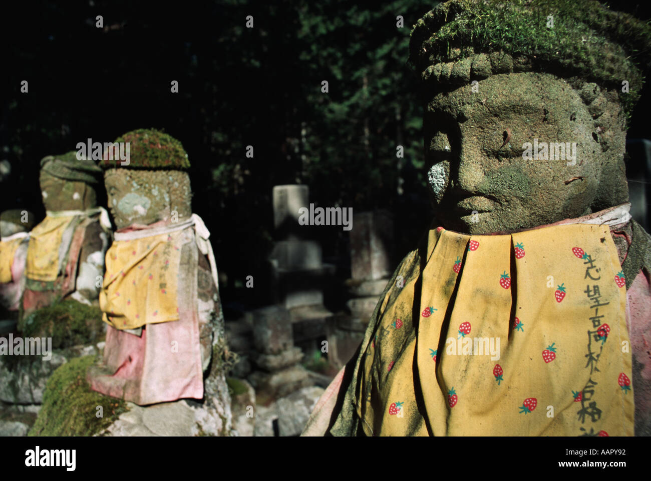 Carved stone statues in the Okunoin the vast ancient cemetery at KoyaSan Mount Koya Wakayama prefecture Japan - Stock Image