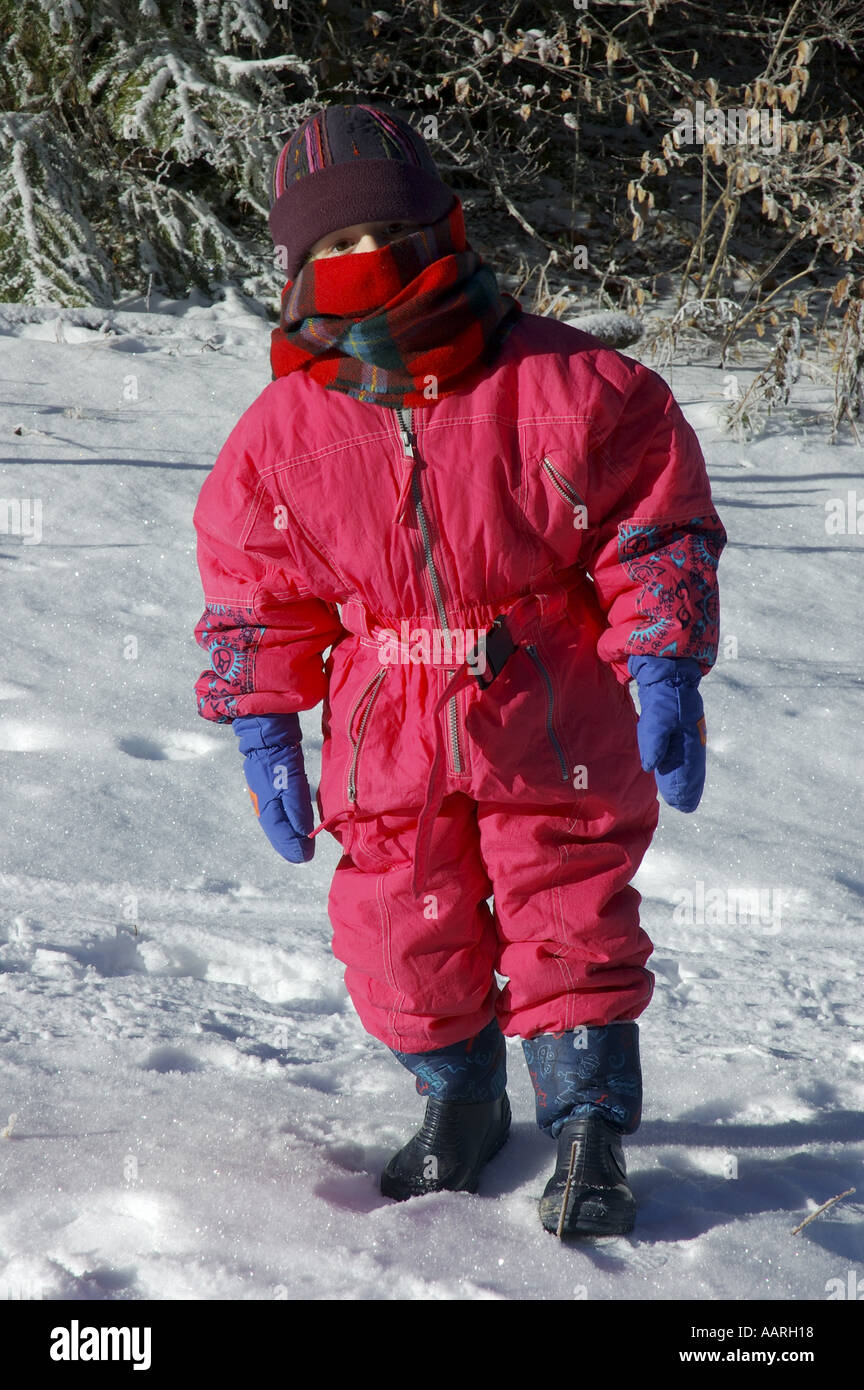 5b73fab0933b3a Little Girl bundled up in warm red winter clothing - Stock Image