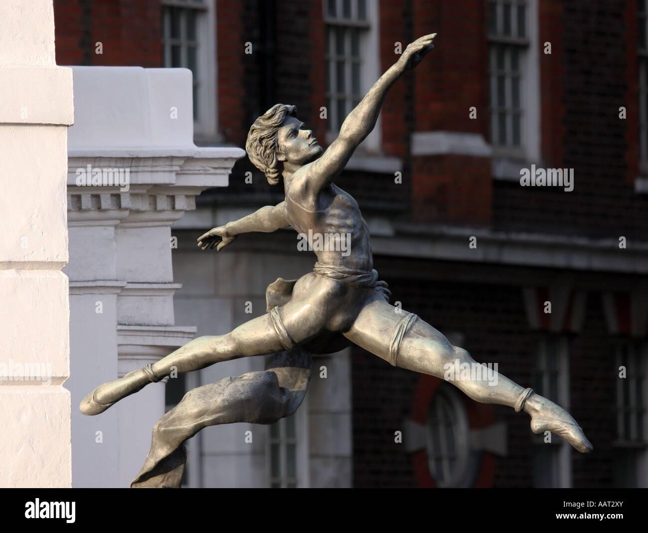 Jeté by Enzo Plazot bronze sculpture of a male ballet dancer outside Tate Britain gallery on London's Millbank - Stock Image