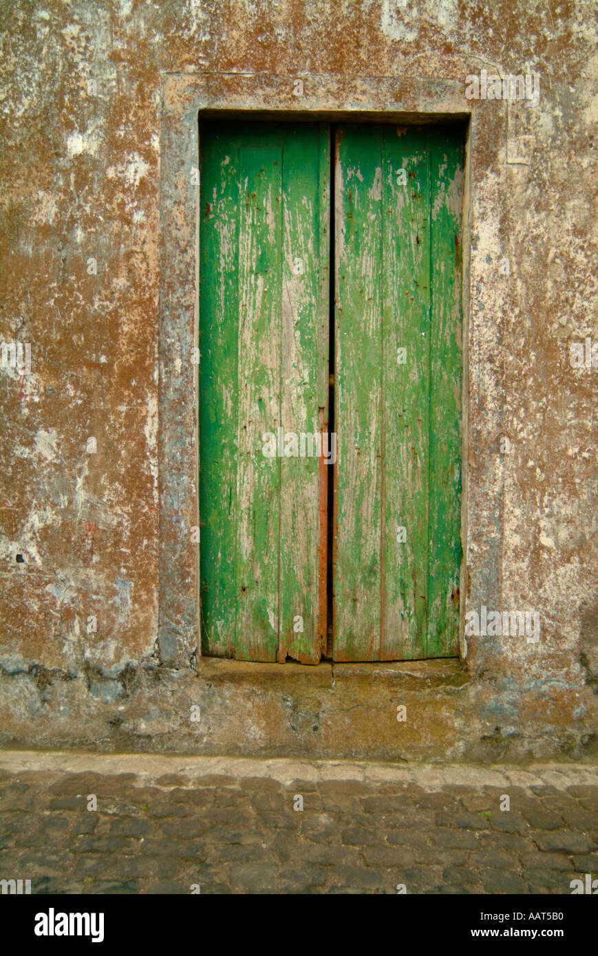 A rustic door in a residential neighborhood in the Azores, Portugal. - Stock Image