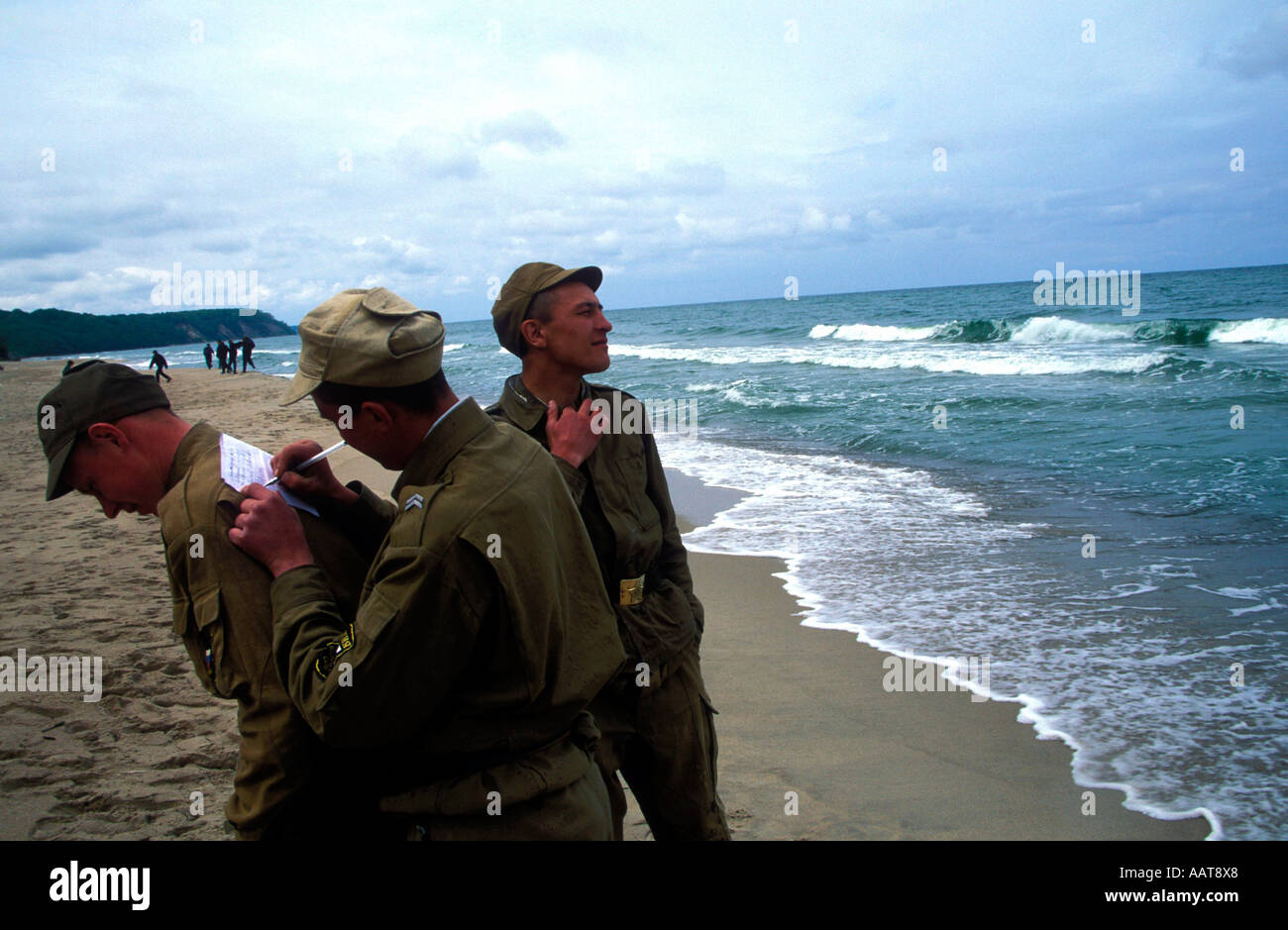 Russian Army conscripts on day leave at Svetlogorsk beach on the Baltic coast writing letters home - Stock Image