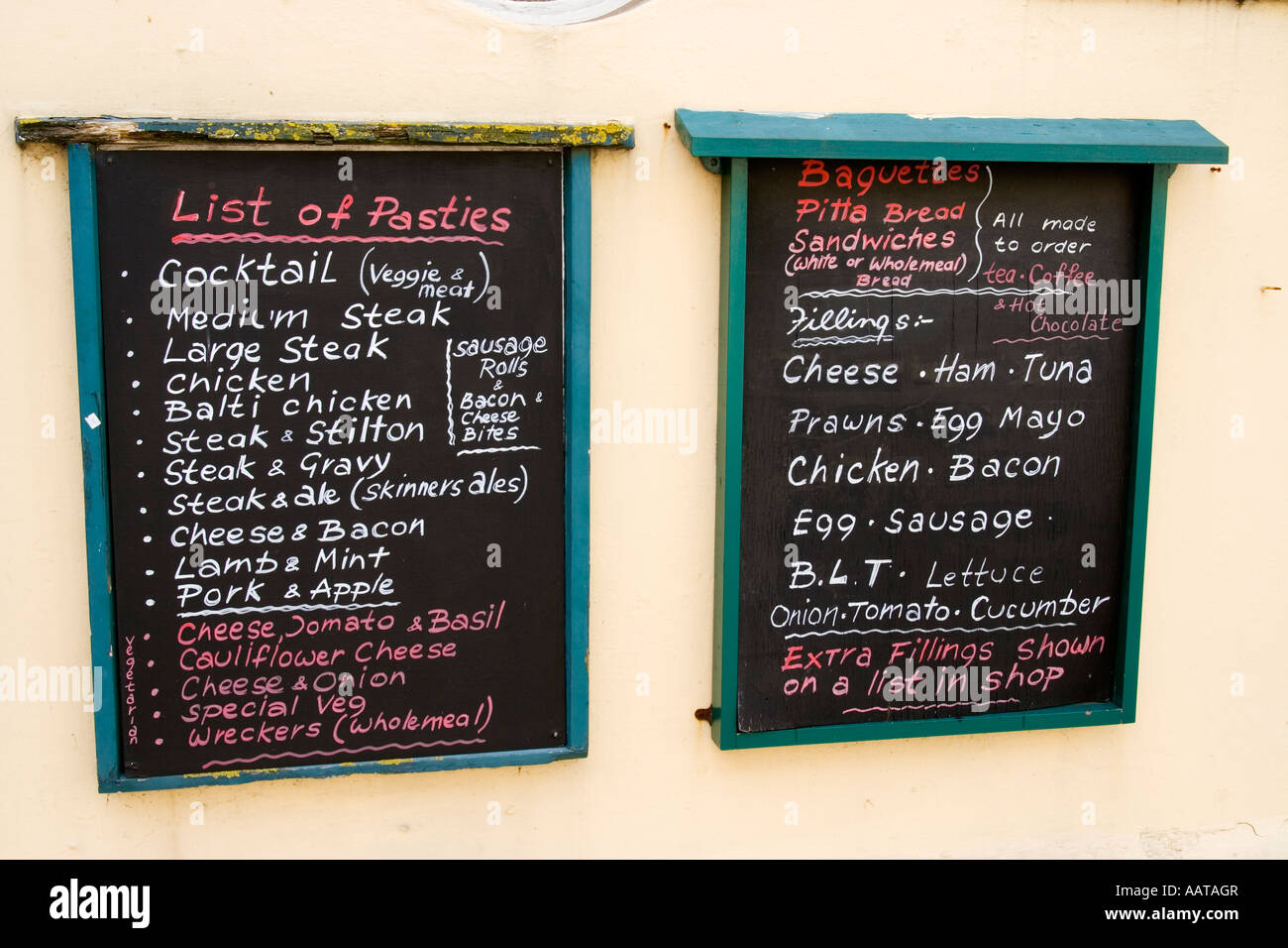Blackboard menus on wall outside pub Falmouth Cornwall UK - Stock Image
