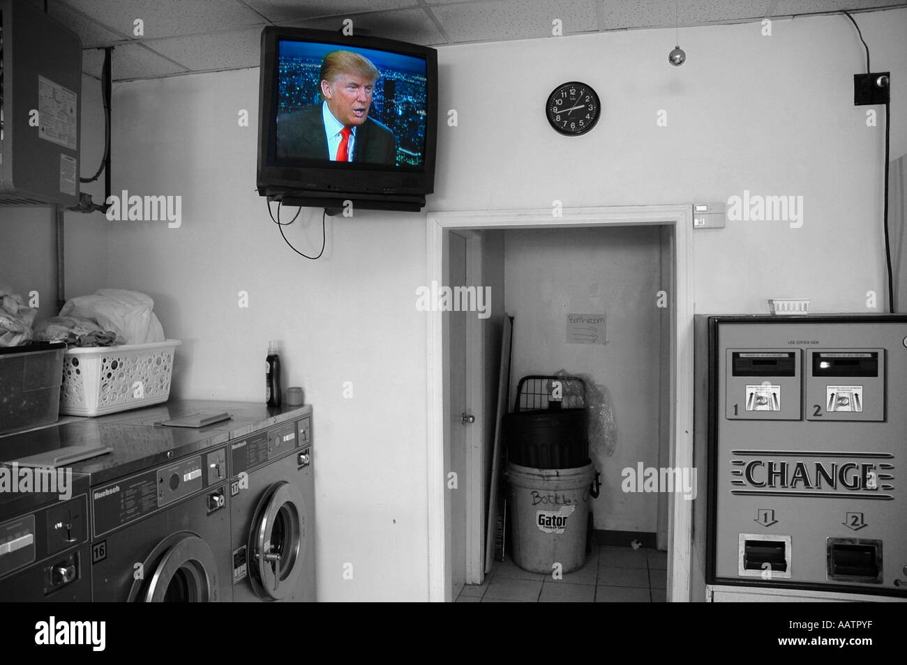 Laundromat with Donald Trump on TV - Stock Image