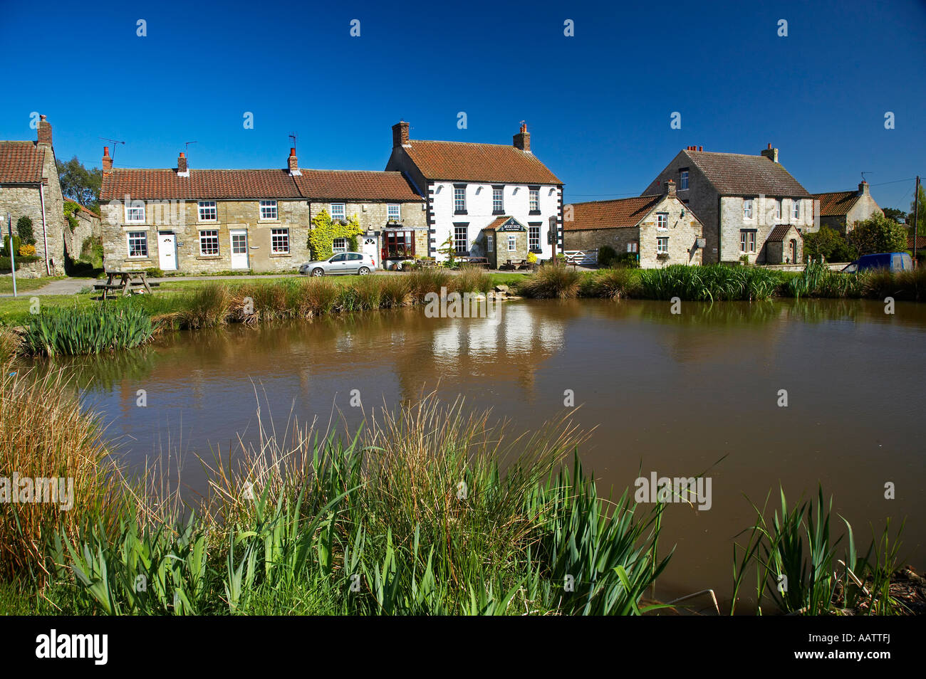 The Mucky Duck Public House and village pond Newton upon Rawcliffe village near Pickering North Yorkshire Moors Stock Photo