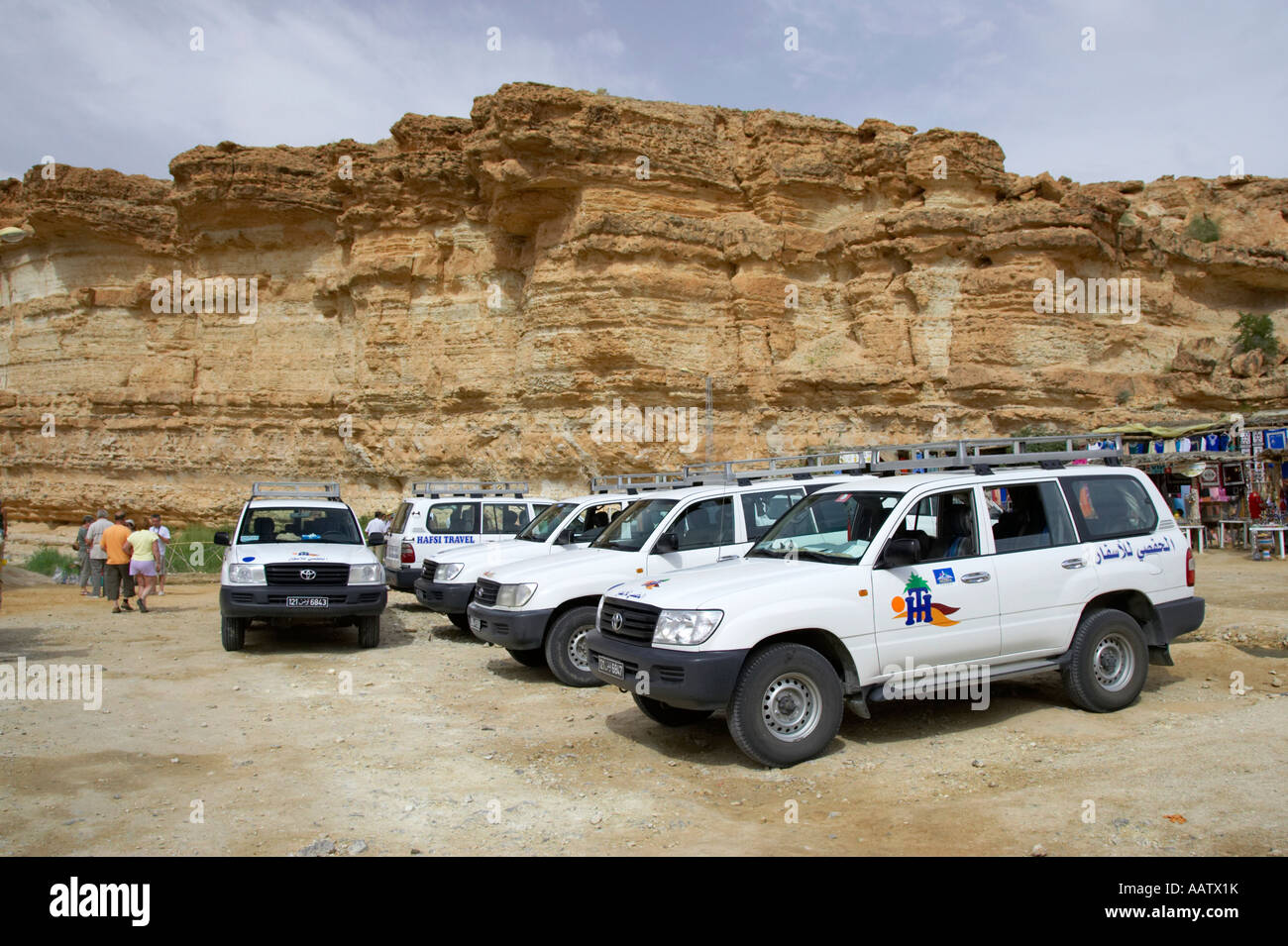 off road tourist vehicles parked in the canyon at tamerza waterfall tourist parking area tunisia - Stock Image