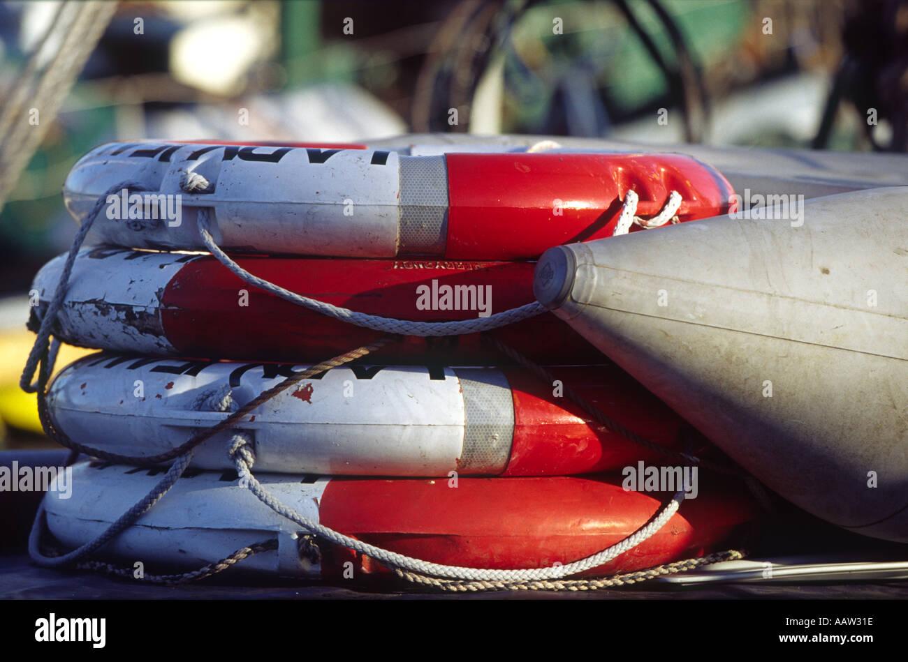 lifebouys stacked at Hythe Quay Maldon Essex England Stock Photo