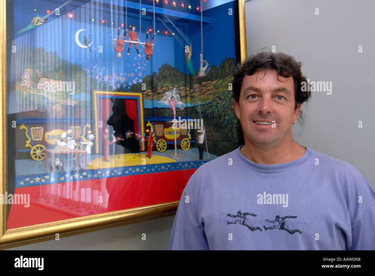 Brent van Rensburg, founder of the Zip Zap Circus School in Cape Town standing next to a miniature circus display. - Stock Image