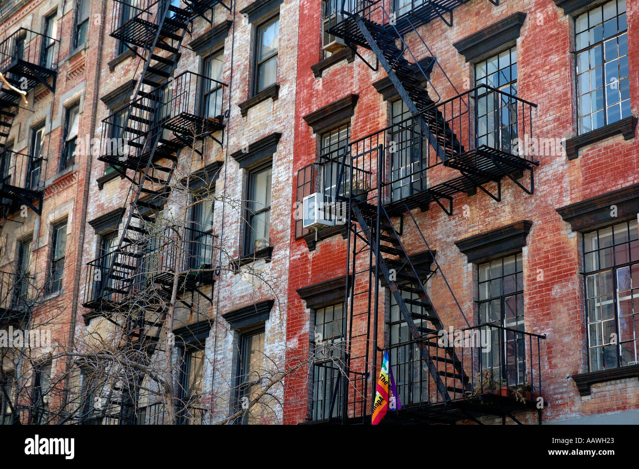 New York Apartment Buildings In Soho Are Of Manhatten With Typical Exterior  Fire Escape Ladders.