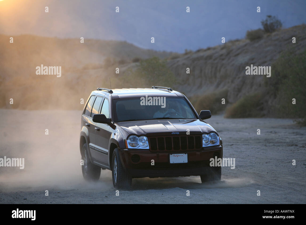 Jeep SUV driving offroad, braking and creating dust, Anza Borrego Desert, California, USA - Stock Image