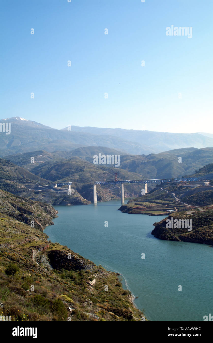 Fresh water supply and storage. Reservoir on River Guadalfeo south of Granada southern Spain. Sierra Nevada mountains. Europe EU - Stock Image