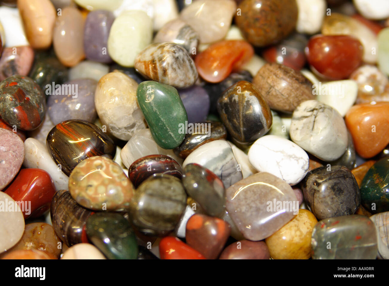 Close-up of an assortment of polished gemstones. - Stock Image