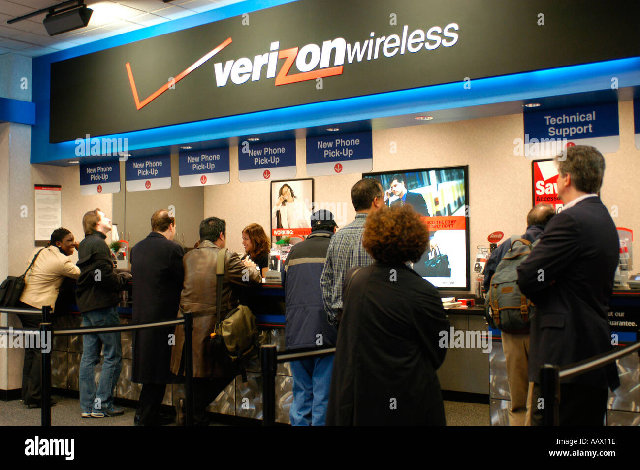Customers purchase cellular phones in a Verizon Wireless Store Stock ...