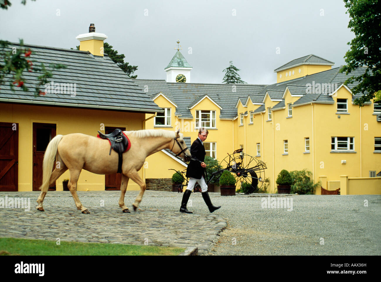 Man with horse at Sheen Falls Lodge in Kenmare, County Kerry, Ireland - Stock Image
