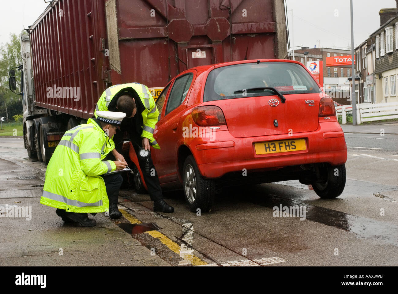 Police Officers investigate road traffic accident (RTA) Stock Photo