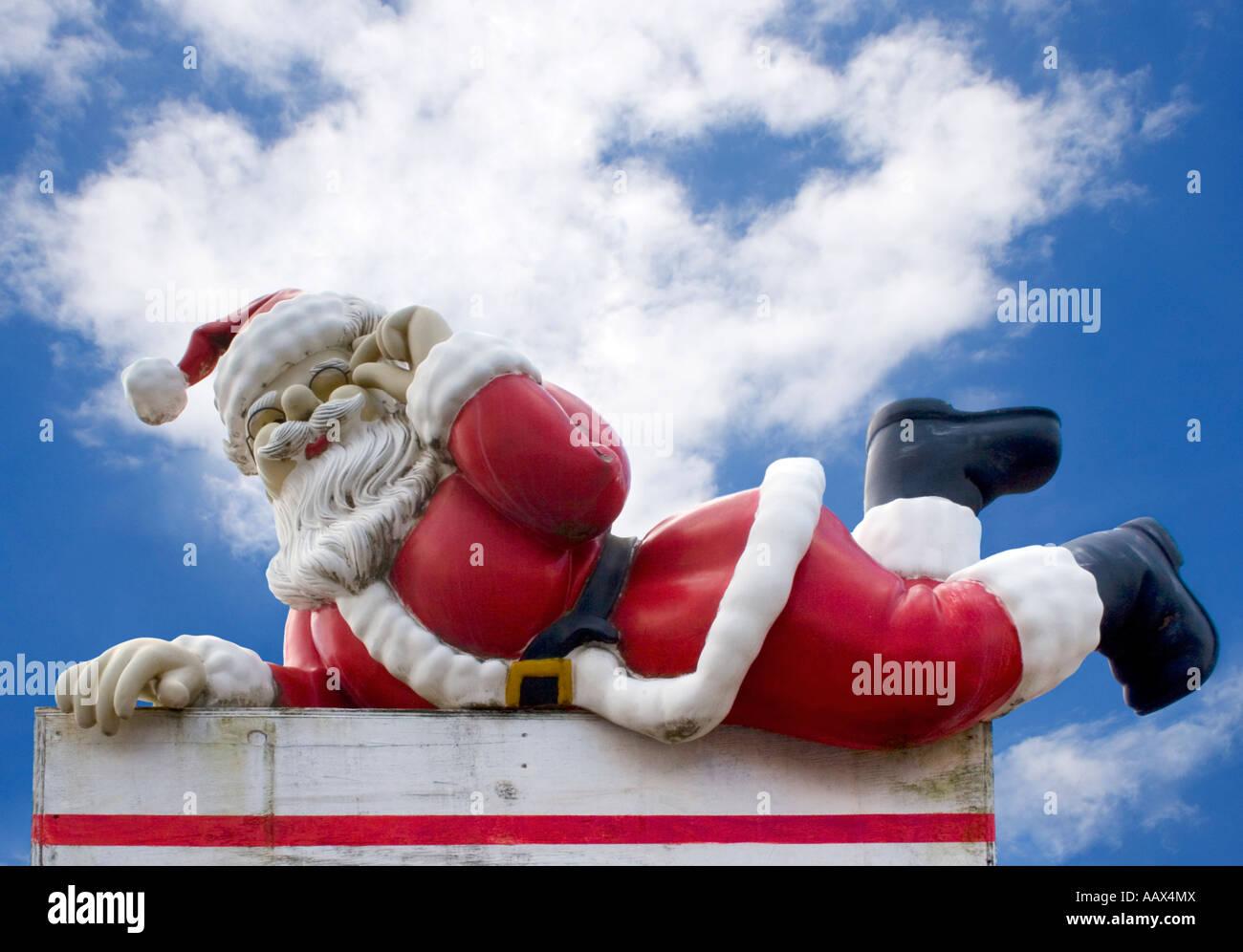 Santa Claus lounging at Santas Workshop in rural CT - Stock Image