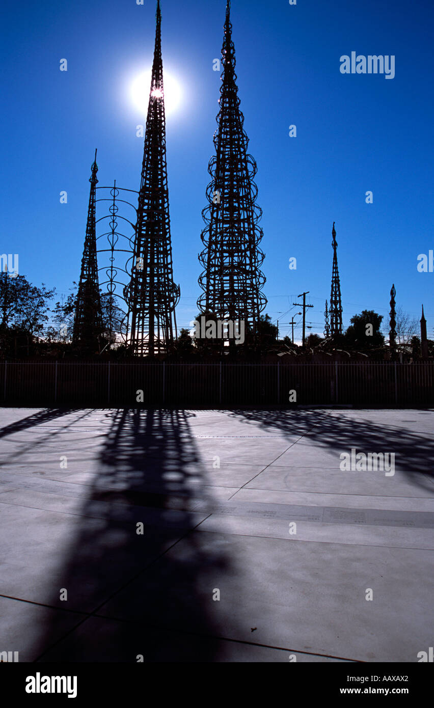 vertical The Watts towers in silhoutte against a deep blue cloudless sky - Stock Image